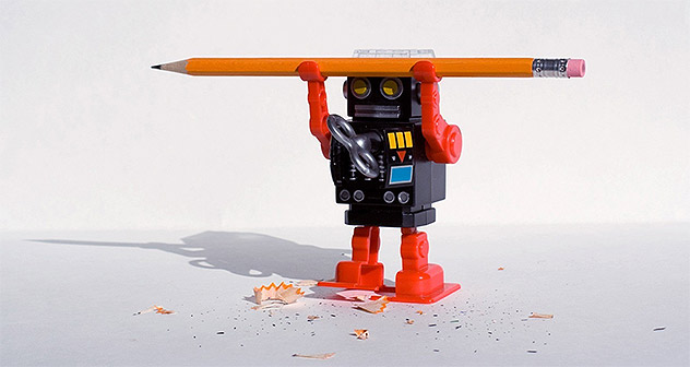 Toy robot holding a pencil.